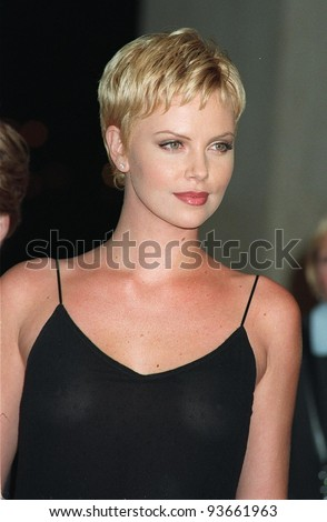 "27OCT97:  Actress CHARLIZE THERON at the premiere in Los Angeles of ""Mad City"" which stars John Travolta & Dustin Hoffman. - stock photo"