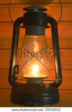 old antique oil lantern in farm - stock photo