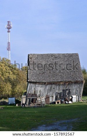 Old barn and the new BTS tower - stock photo