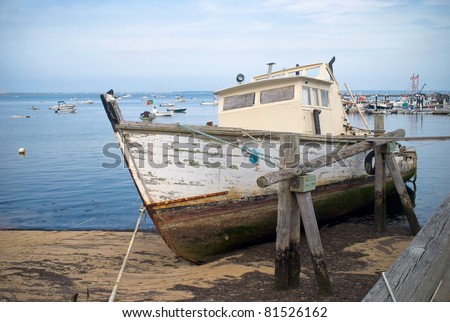"""""""Old Boat""""  An old boat in Provincetown Harbor on Cape Cod in Massachusetts. - stock photo"""