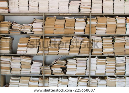 old books in a old library - stock photo