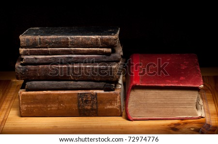 old books on a wooden shelf - stock photo