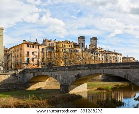 Old bridge ( Pont de Pedra) in center of Girona, Spain - stock photo