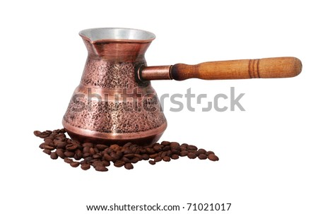 old coffeepot and coffee beans - stock photo