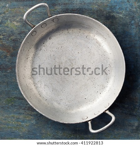 old empty cooking pot on rustic wooden background, top view composing, copy space - stock photo