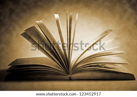 Old Fashioned Open Book Lighted Vintage Background - stock photo