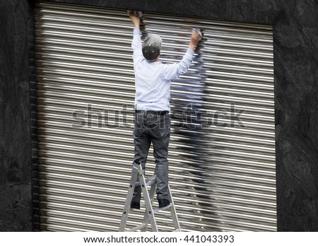 old  man working cleaning metal shutter door  without safety equipment  in  danger   in  metal ladder - stock photo