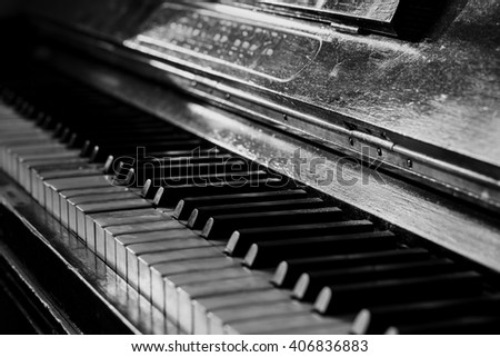 Old rusty piano keyboard, selective focus, black and white  - stock photo