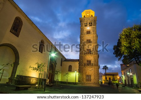 Old Town of San Cristobal de La Laguna (Tenerife, Canary Islands, Spain) at night. A Catholic church of the Immaculate Conception (Iglesia-Parroquia Matriz de Nuestra Senora de La Concepcion).  - stock photo