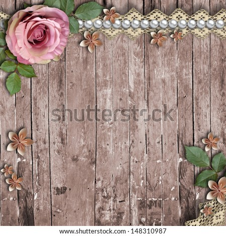 Old wooden background with a flowers, pearls and lace ...