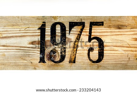 1975 Old Wooden Box on a White Background - stock photo