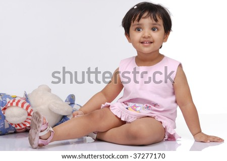 2-3 old year baby girl sitting over white background - stock photo