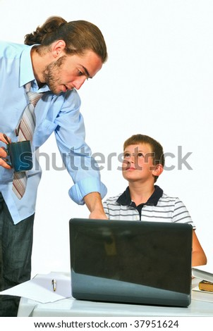 Older brother teaches his younger brother, work with computer - stock photo