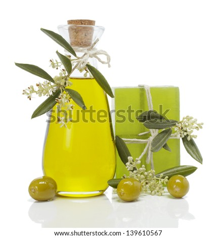 Olive soap with a sprig of olive blossoms, oil and olives  isolated on white background - stock photo