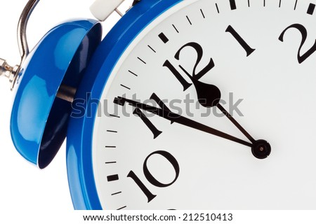11:55 on a clock. time for decisions - stock photo