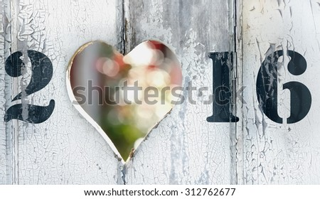 2016 on a door with heart shaped hole  - stock photo