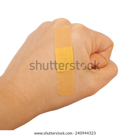 On a man's hand fist glued medical plaster first aid plaster advertising on a white background.  - stock photo