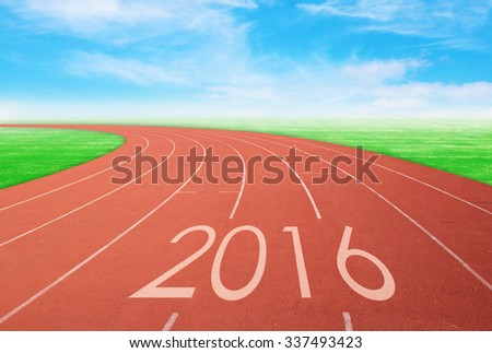2016 on red racing track with green grass and  blue sky. 2016 new year concept - stock photo