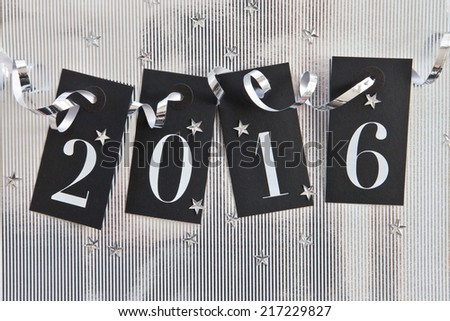 2016 on shiny background with star confetti - stock photo