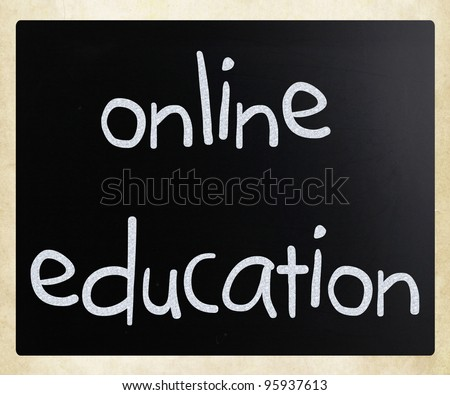 """Online education"" handwritten with white chalk on a blackboard - stock photo"