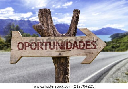 """Oportunidades"" (In portuguese - Opportunities) wooden sign with a landscape background  - stock photo"
