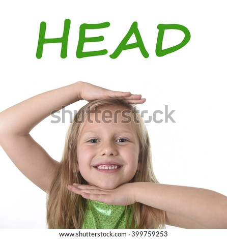 6 or 7 years old little girl with blond hair and blue eyes smiling happy posing isolated on white background showing head in learning English language school education body parts card set - stock photo