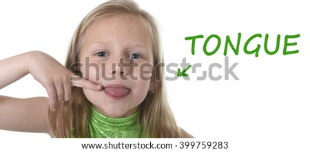 6 or 7 years old little girl with blond hair and blue eyes smiling happy posing isolated on white background pointing tongue in learning English language school education body parts card set - stock photo