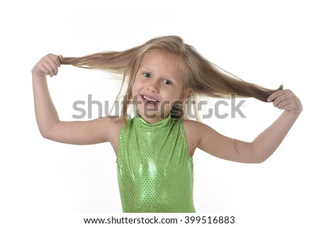 6 or 7 years old little girl with blue eyes smiling happy posing isolated on white background pulling her blond hair in language lesson for child education and body parts school chart set - stock photo