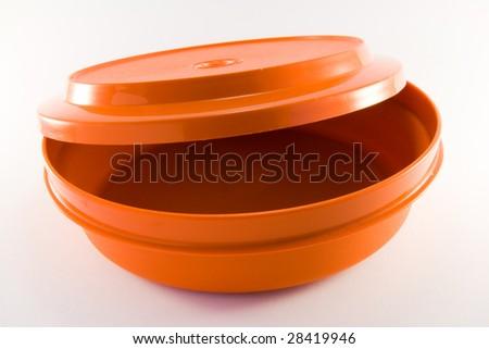 1 orange plastic food container - stock photo
