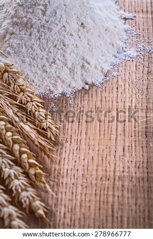 organized copyspace heap of flour and wheat ears on wooden board food and drink concept - stock photo