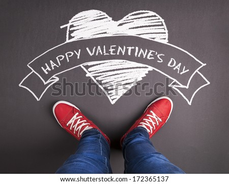 Original Valentines Day love concept with red sneakers and chalk drawn heart symbol. - stock photo