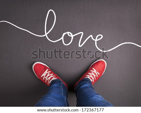 Original Valentines Day love concept with red sneakers and hand drawn text. - stock photo