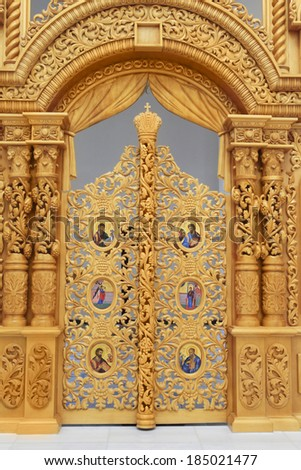 Orthodox Holy Transfiguration Cathedral. New carved wooden doors into the altar of an Orthodox church  in Odessa, Ukraine - stock photo
