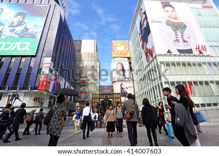 OSAKA, JAPAN - NOV 6: Tourists visits at The Glico Man advertising billboard and other in Dontonbori, Namba area on November 6, 2015 in Osaka, Japan. Namba is primary tourist destination - stock photo