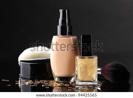 ?osmetics isolated on black - stock photo