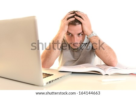 Overwhelmed Stressed and desperate Student  with Book and Laptop - stock photo