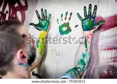 painted hands among the ruined walls - stock photo