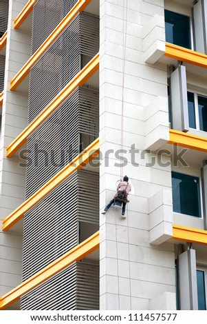 Painter paint the facade of building - stock photo