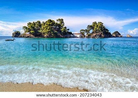 Panagia isle at Parga in Greece. Ionian sea and a sandy beach.  - stock photo