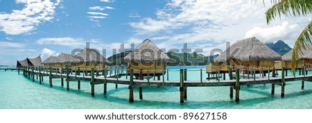 Panorama view of over water bungalow in  Bora Bora , the famous island of French Polynesia , south Pacific . - stock photo