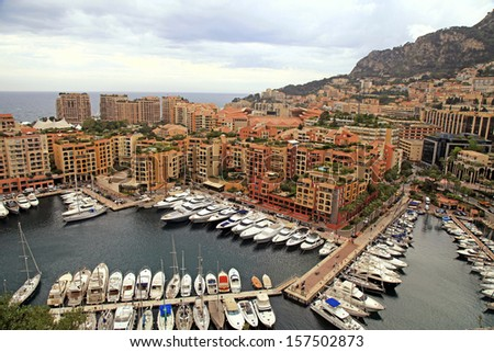 Panoramic landscape with harbor, lots of yachts in famous Monte Carlo, Cote d'Azur - stock photo