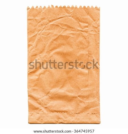 Paper bag for fruit or bread isolated over white vintage - stock photo
