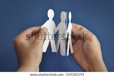 'Paper people' in the hand - stock photo