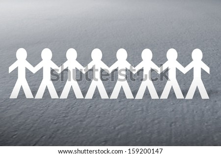 paper people on gray  background  - stock photo