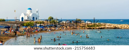 PARALIMNI, CYPRUS - 17 AUGUST 2014: Crowded beach with tourists - stock photo