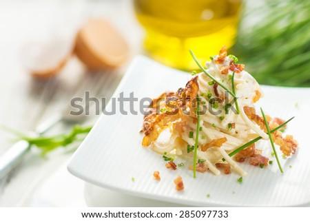 Pasta carbonara with bacon  - stock photo