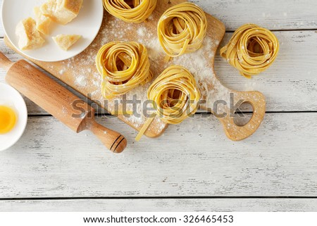 pasta on cutting board, food top - stock photo