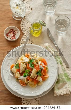 pasta salad with smoked salmon and artichokes - stock photo
