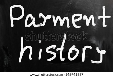 """""""Payment history"""" handwritten with white chalk on a blackboard - stock photo"""