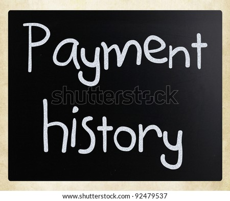 """Payment history"" handwritten with white chalk on a blackboard - stock photo"